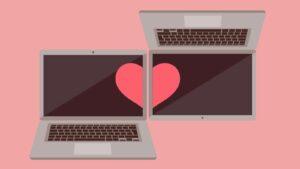 ilustração de dois notebooks com um coração simbolizando namoro à distância