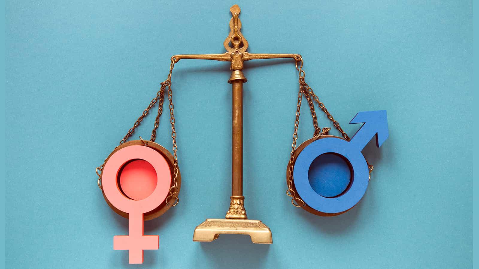 balança jurídica com símbolos feminino e masculino