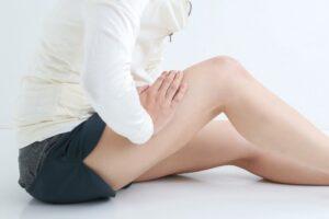 dor nas pernas durante a menstruação